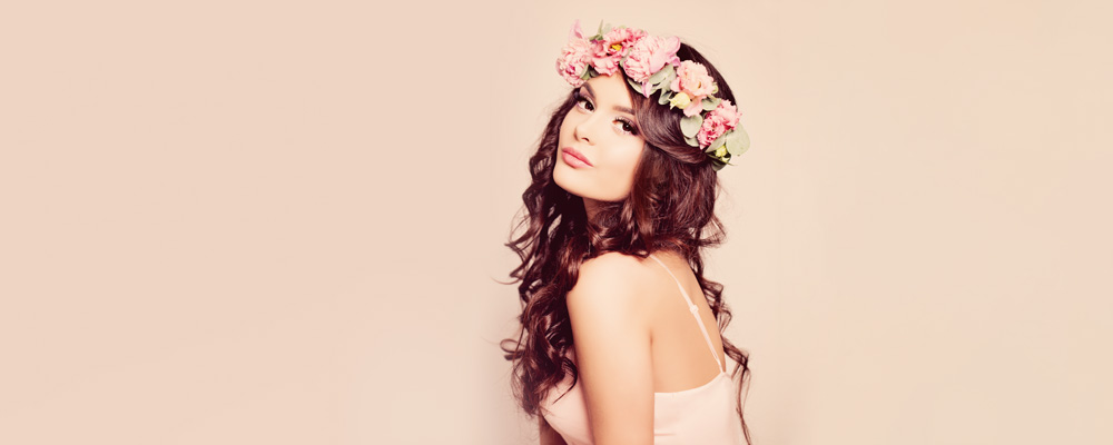 Brunette Woman With Curly Hair And Flower Tiara